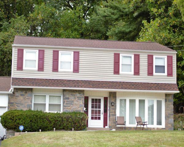 asphalt shingles on two story home