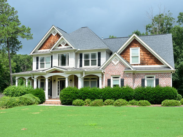 newly roofed home in delaware county with large front yard and row of shrubberies