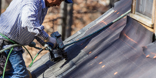 roofing contractor at work on west chester home