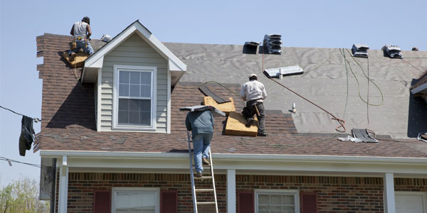 roofing professionals working on west chester home