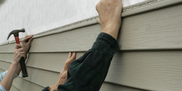 siding contractors at work on chester county home